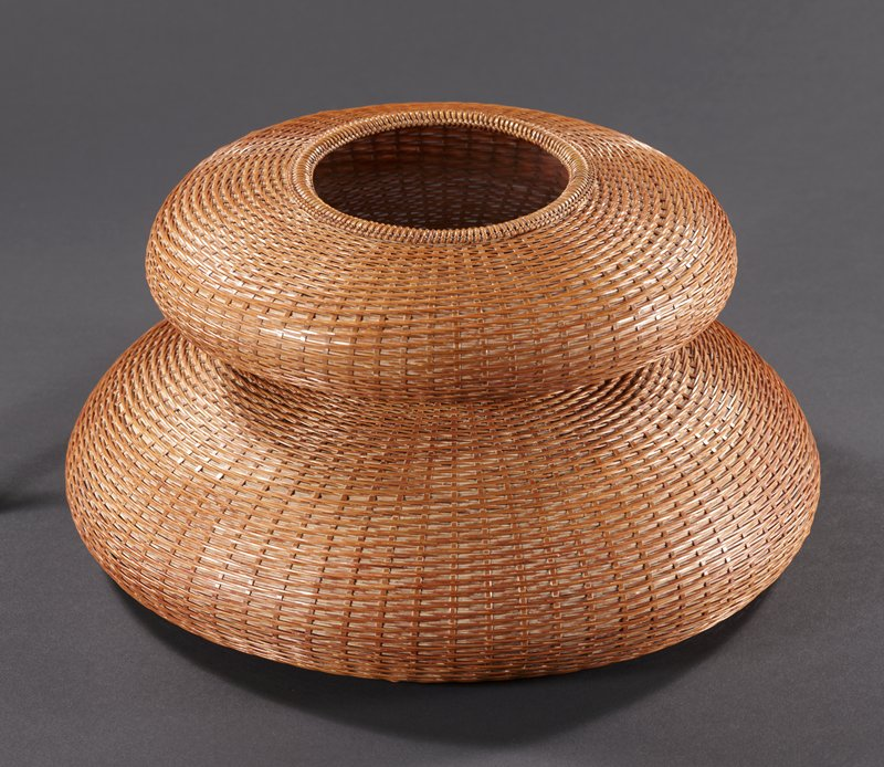 two-tiered round basket with squat, round shape; closed weave