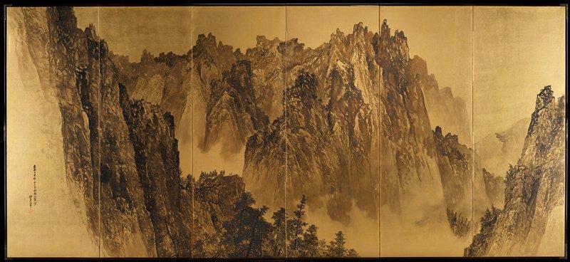 black wash of mountain scene on gold leaf background