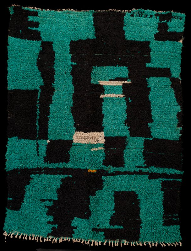 soft pile on woven cotton ground; green, black and white abstract geometric designs with one small rectangular gold area