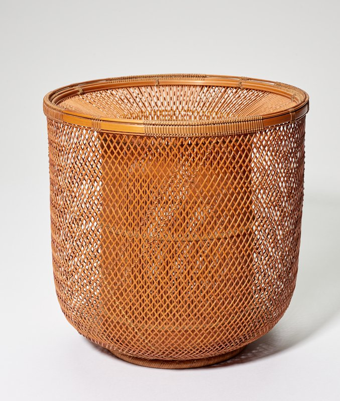 straight sides; rounded at bottom with ring foot; wide inward-flaring rim; open wall between inner vertical strips of bamboo and outer woven bamboo, with some strips on outer wall twisted with slightly more golden-colored thin bamboo; black lacquer inner flower container