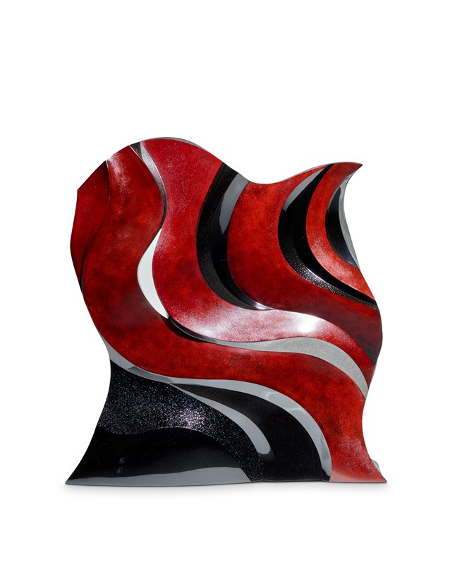 standing flame like form with waving vertical bands in matte red, matte black, glossy black with gold dots, and glossy black with embedded sparkles; small cutout near bottom; one of pair