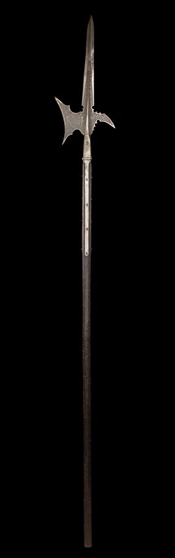 "axe-like weapon on wooden staff; head etched on each face with scrolling foliage against a stippled blackened ground; axe-blade with the crossed staves of Burgundy impaling a coronet and dividing the letters ""FAR""; head with open socket and four side-straps; wooden haft (probably original)"