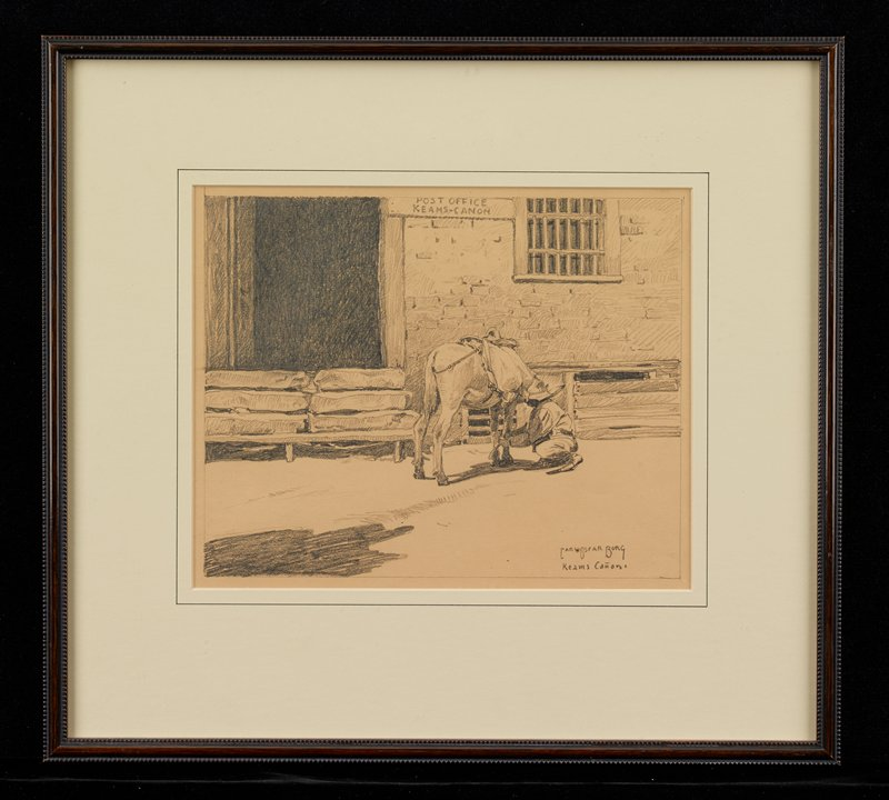 """crouching figure examining the front leg of a horse wearing a saddle in front of a brick wall with a barred window and a sign reading, """"POST OFFICE / KEAMS-CANON]"""