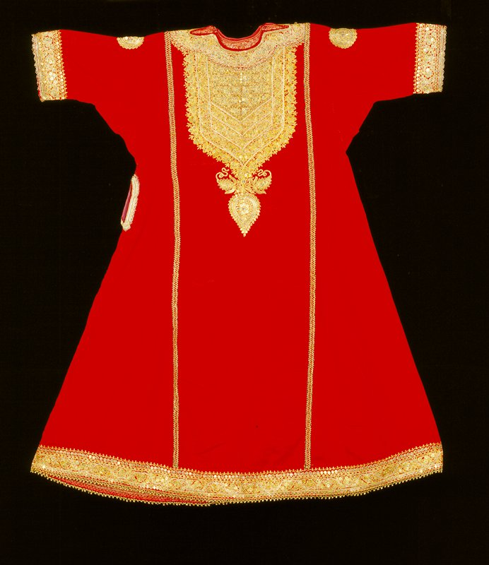 red silk tunic with metallic (gold) decorative embroidery at hem, wrists, chest and in two bands running vertically up front