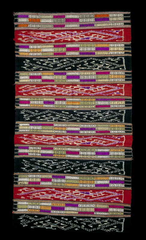 Alternating stripes of black and white ikat; white, green, dark pink, light yellow, purple and tan brocade and red, purple and white ikat