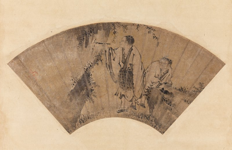 mounted fan painting: man in white robe holding a calligraphy brush up to the side of a small cliff or rock formation covered with foliage; shorter man behind him leans over a rock, looking on; ivory roller ends