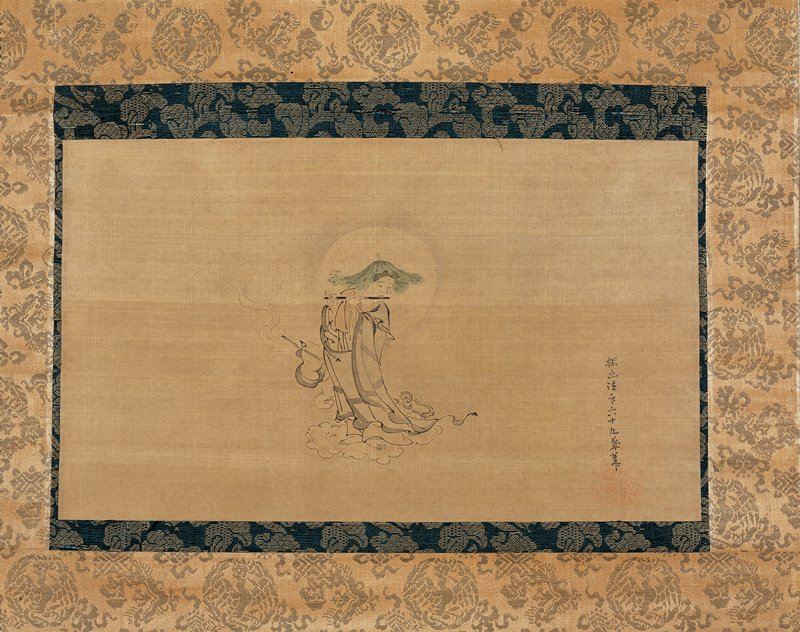 robed male figure with lotus leaf hat playing flute while standing on a cloud; pale halo around head