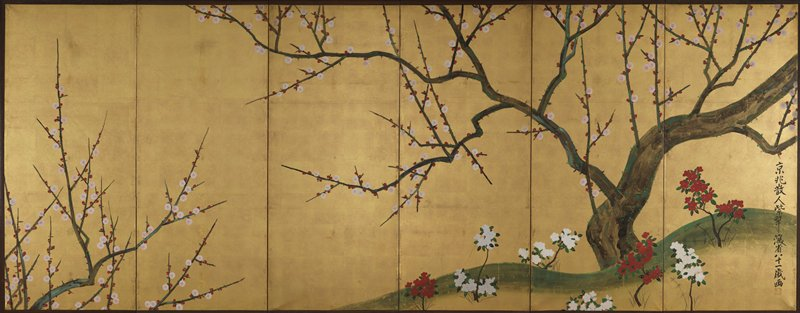 crooked, moss-covered tree with sprawling branches spotted with pink and red plum blossoms on low green hill at R; tips of blossoming branches at bottom L