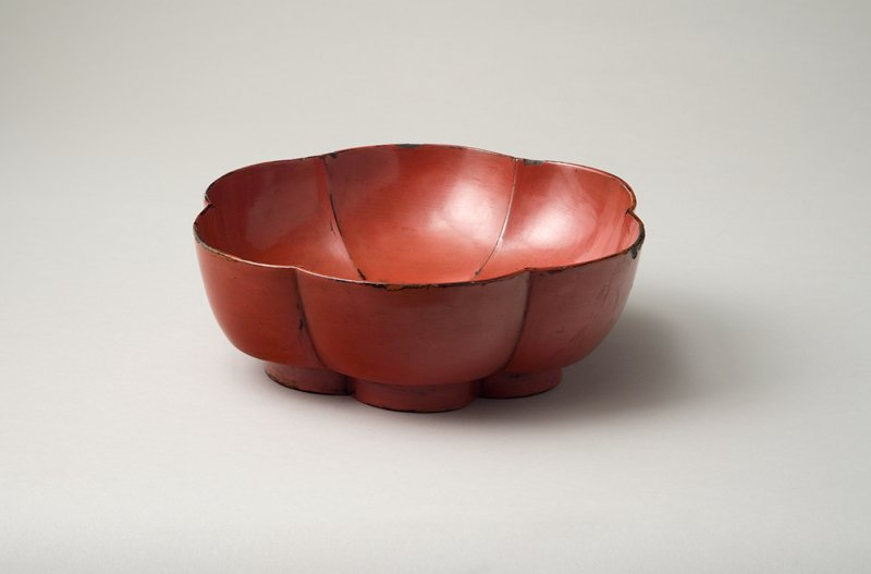 bowl with lobed, upright walls resembling flower petals