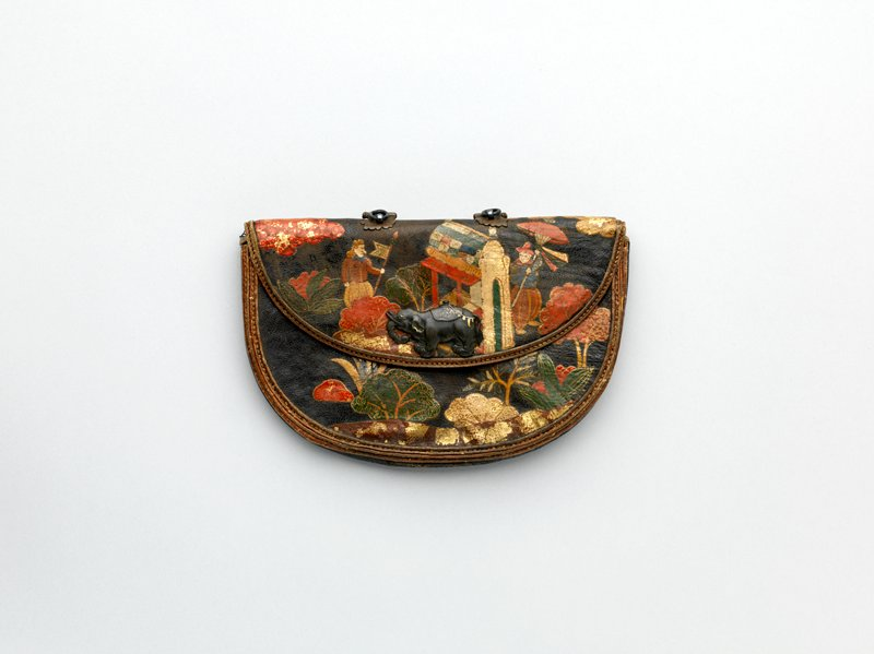 painted and gilded leather pouch with designs of large nosed Portuguese men in a landscape; man in boat on water on one side; men in front of a stylized building opposite; metal elephant clasp on one side