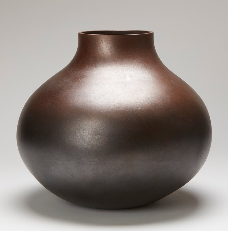 black vessel with metallic sheen; wide body with short but wide neck