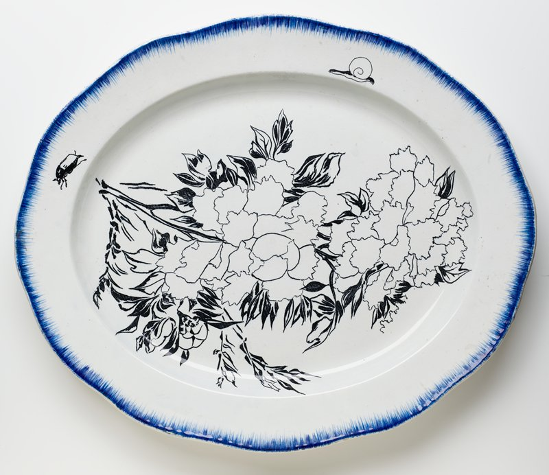 white oval platter with scalloped edge; brushed blue pigment around edge with peonies, a snail and a beetle painted in black