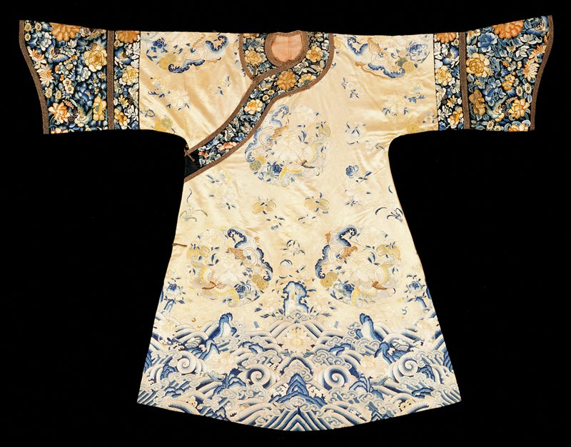 Robe of Ivory Silk embroidered with lower border of crested waves above which are bold floral and butterfly medallions and floral sprays; various shades of blue, green, yellow and salmon; sleeves similar but with more brilliant coloring on black ground; Pekin.