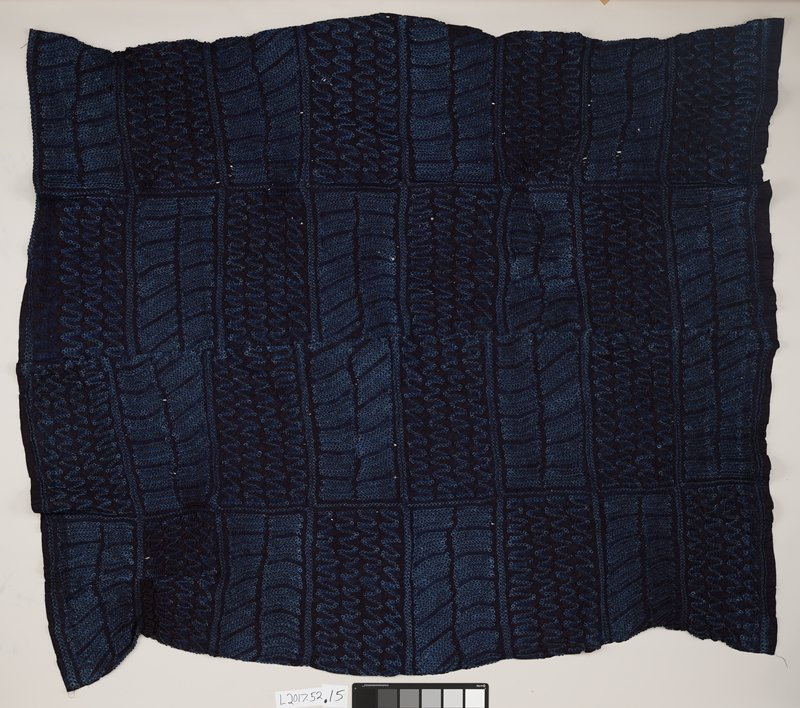 dark indigo with tie-dyed circles; bands of zigzags and vertical lines separated by horizontal bands