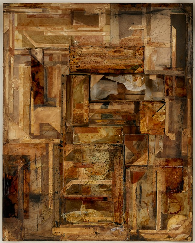 """abstract assemblage in browns, tans, grey, black and cream; raised rectangular box-like elements at center--some open, some """"closed""""; predominately horizontal and vertical layered elements of various colors and textures; one open rectangular box has thin paperlike elements in various layers; wavy black lines and small frenetic tic marks particularly concentrated on topmost closed rectangular box and at bottom center; metal envelope clasp at top left of center; received in a shadowbox with silver edging"""