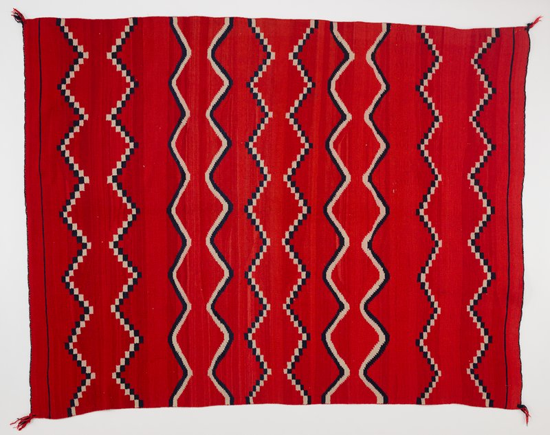 red background with tan and blue double-lined zigzagging pattern; Velcro header on reverse