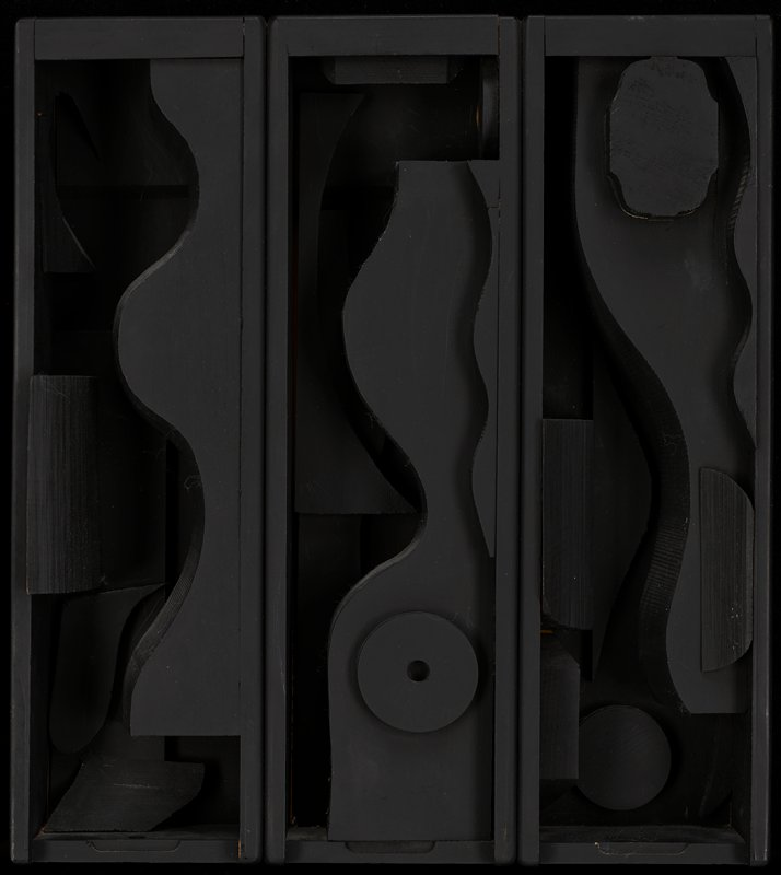 wooden sculpture painted black; three attached rectangular boxes with wooden abstract shapes adhered inside boxes in a mixture of round and wavy elements as well as short, round shapes