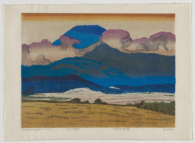 abstracted mountain landscape with tan field in foreground with line of green trees behind it; grey middle ground with darker grey lines; medium to dark blue mountains with lavender and grey clouds; orange at top of sky