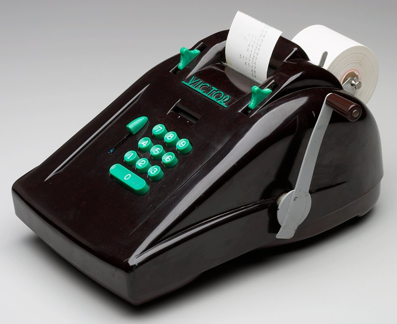 manual adding machine with dark brown cover, metal handle with brown knob and green plastic keys and buttons