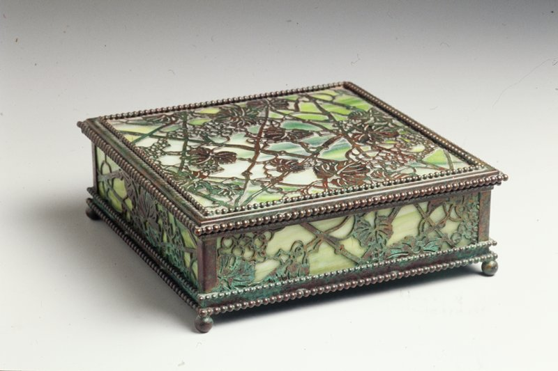 box with hinged lid; green and white swirled glass with copper openwork leaf and stem overlays on top and sides; ball feet