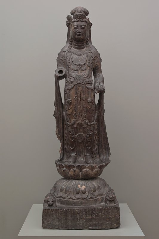 Standing Guanyin with lotus bud(?) in left hand, right hand missing, inscribed base which bears the date 571 A.D., translation of inscription filed with purchase blank, from Xi'an in Shaanxi province.