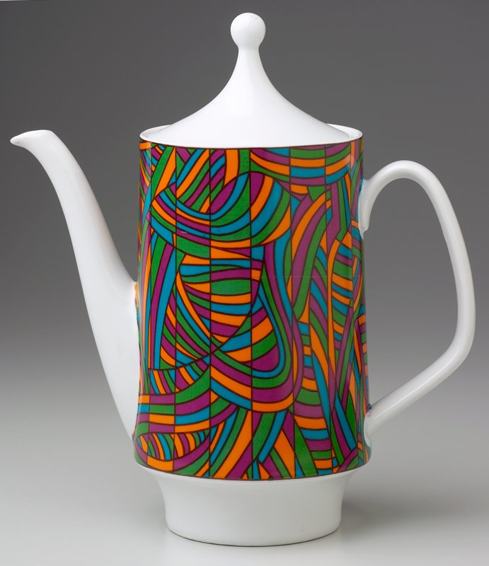 slightly tapering cylinder on concave base; thin handle and long, thin spout; conical cover with round knob; blue, orange, maroon and green geometric and organic design around body