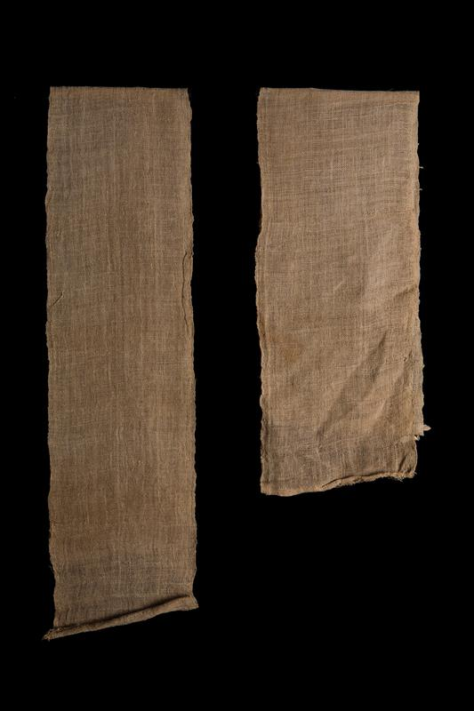 long, tan-colored loosely woven panel