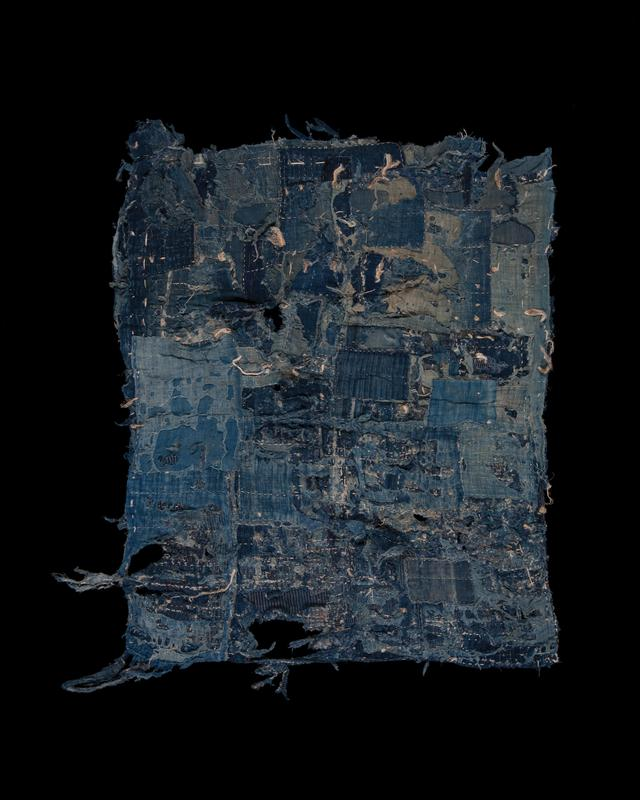 cotton patchwork in various shades of blue; rectangular striped patch at end