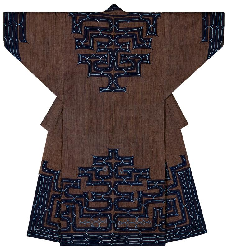 blue and brown/green striped robe with navy blue applique trim on sleeve cuffs, collar and yoke, center back, and around bottom section; light blue embroidery over navy applique creates curving lines and points