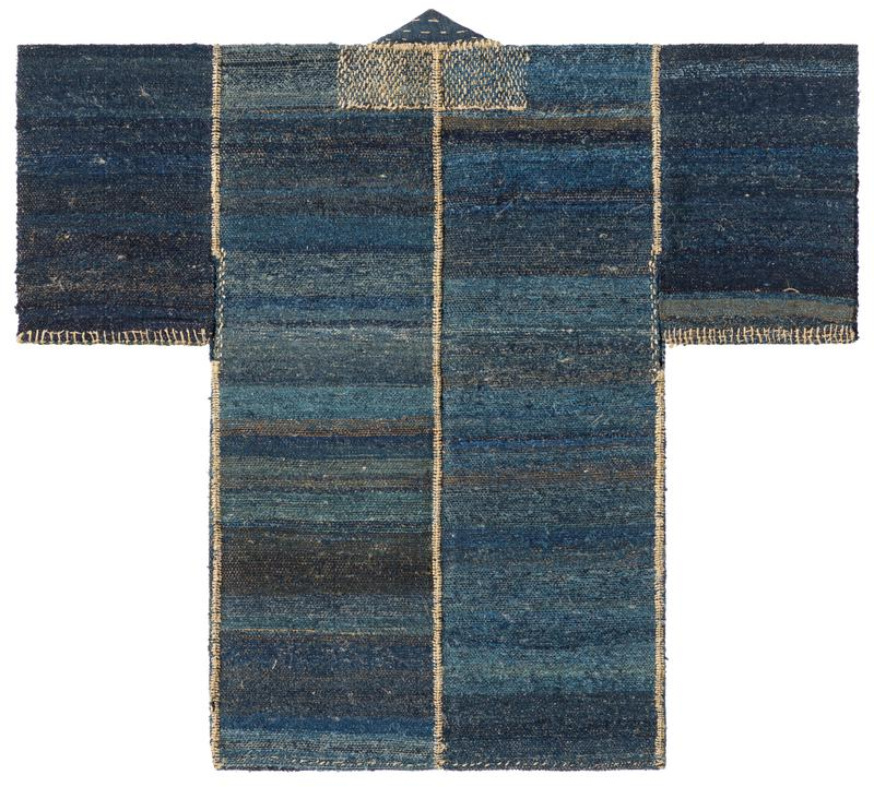 coarse, woven coat; woven in gradients of blue to black; off-white embroidery around collar