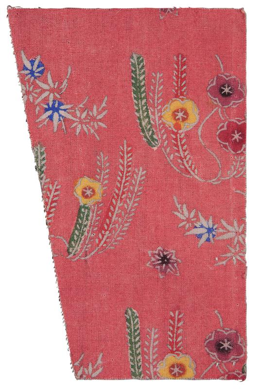 trapezoid-shaped fragment of pink fabric with floral pattern; gray flowers and stems with blue, yellow, red, and green accent colors
