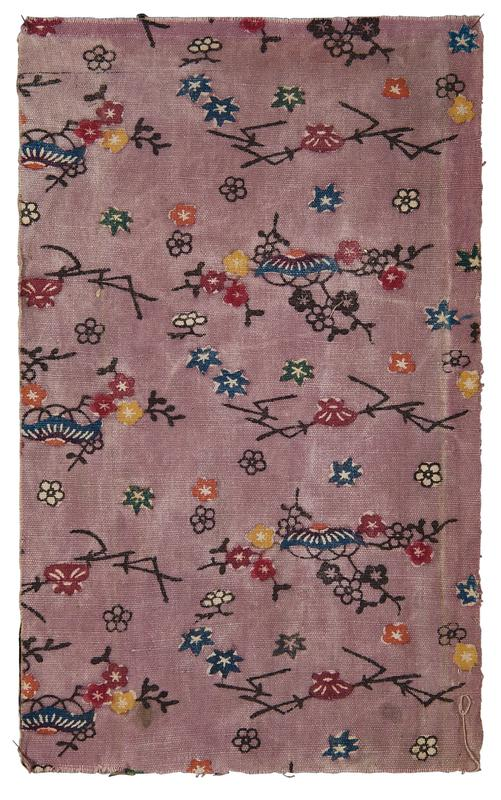 rectangular fragment of purple fabric with multicolored floral pattern; black vines and branches with red, orange, yellow, blue, green, and pink flowers and leaves