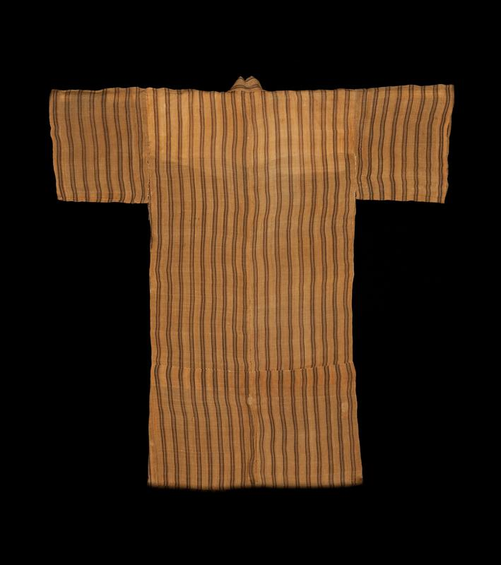 orange-brown robe with brown, vertical stripes; white, interior lining over shoulders and upper back