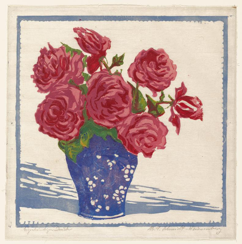 group of seven red and pink roses in a blue vase; white background with blue border and blue shading along the bottom