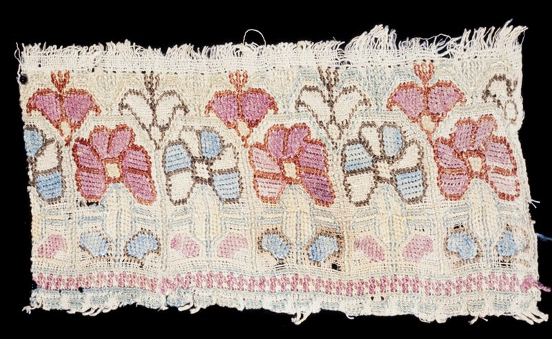 A strip of curious colored embroidery, blue, pink and green. Interesting use of stitches for obtaining effect. Design intact.