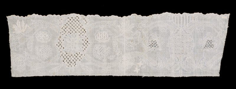 Lace, portion of Tonder lace flounce with scalloped border; only one thickness of muslin is used. The floral forms are defined with a cordonnet.