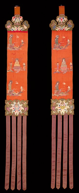 Banner, one of two; red satin ground embroidered with three rows of figures, terminating at top in green satin scroll, set with mirror discs, and at bottom with scroll and four purple streamers reversible.