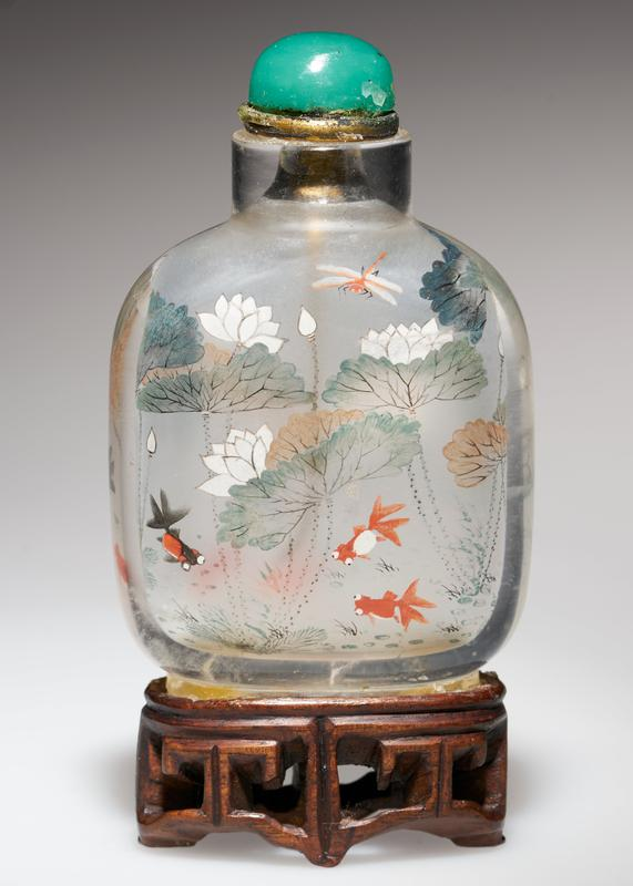 snuff bottle; crystal with beryl top; delicately painted inside with lotus
