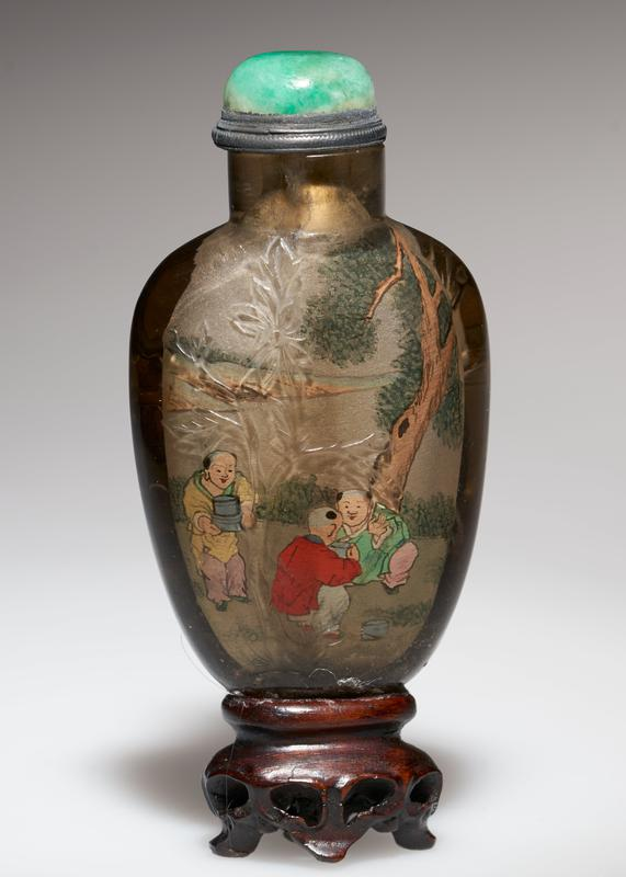 Snuff bottle. Smoky crystal. Green jade top. Painted inside. Four children and one larger figure. Crystal, carved on the outside.