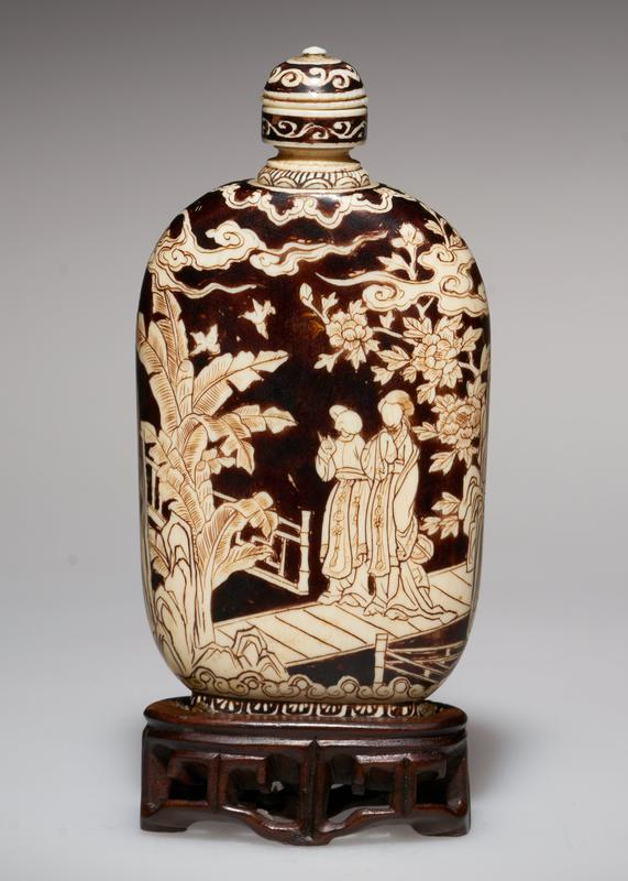 ivory overlaid with red lacquer, ivory top; very beautifully carved; beautiful detail on neck of the Bottle; note the Peony Tree, not a shrub; emblematical of good fortune, love and affection; next to the chrysanthemum, the peony was the chosen flower; beautiful color both of ivory and lacquer