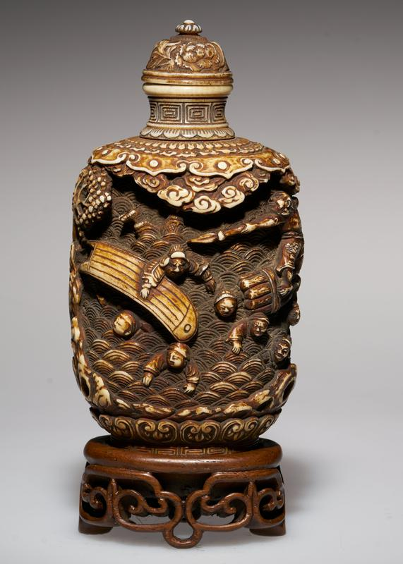 ivory, carved and colored; carved ivory top; carving represents people struggling against a flood