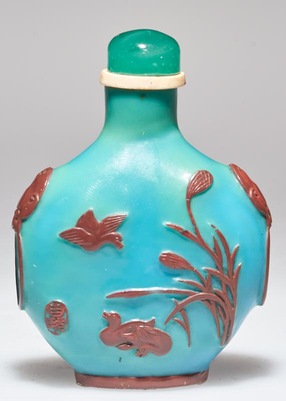 green glass top; peacock blue glass; dull lacquer red carving