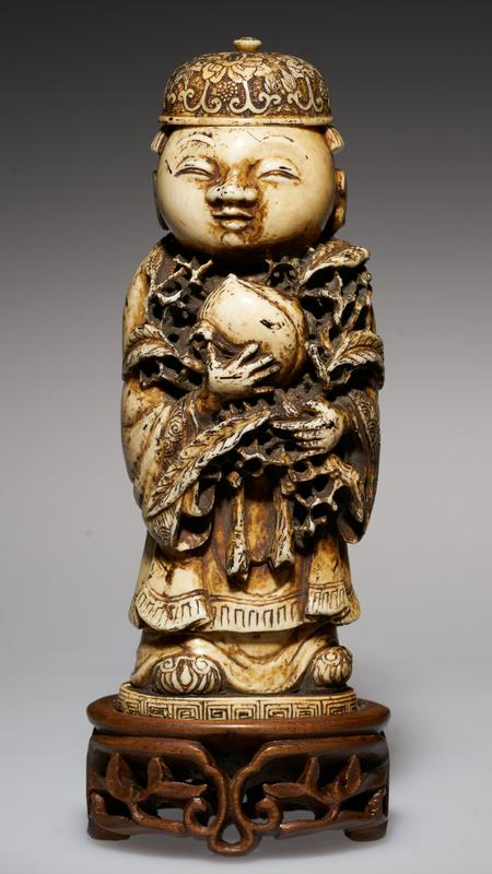 carved ivory figure; carved ivory cap as stopper; holding immortal peach