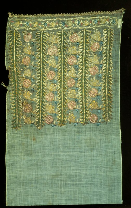Towel-scarf, of fine material embroidered in colored silks, gold thread and tinsel in a border at each end made of five vertical green stalks with bands of pink and gold flowers between every two stalks. Finished the same at each side. Gold lace finishes each end. Both sides bound with a white silk thread. Seam in center. Cotton, silk embroidery.