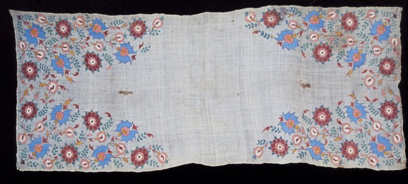 Towel of loosely woven linen material embroidered in silk thread with pattern at each end of leaves, flowers and vines which fill the corners leaving a diamond shaped panel of plain material in the center. Blue and shades of rose are the predominating colors. Linen.