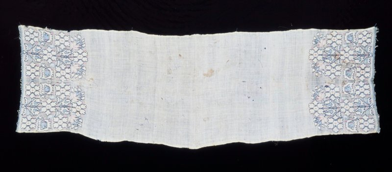 Towel-scarf embroidered in linen thread with two conventionalized flowering plant motif forming border at each end. White, pink and shades of blue thread used.