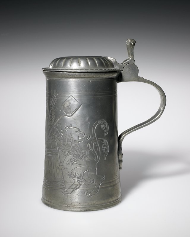 tankard, with massive scrolled thumbpiece, device of brewers guild on front, makers mark on handle and Tudor rose inside bottom