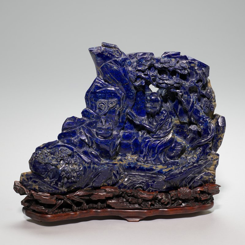 Lapis Lazuli carving in the form of a mountain with a poem incised on the back.
