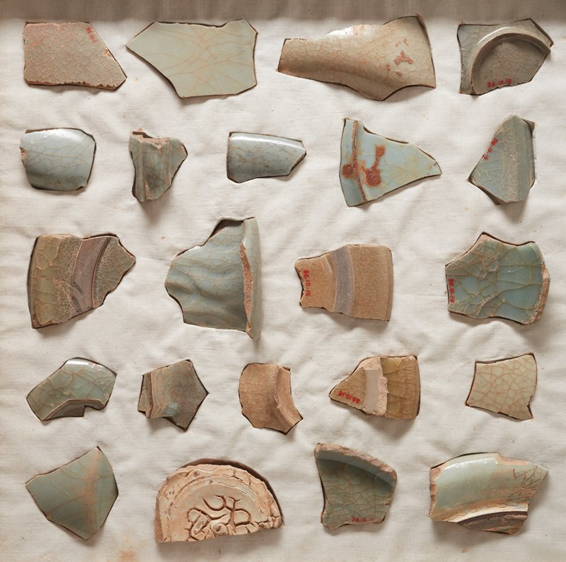 Fragment of bowl, pale porcellanous body, smooth, even glaze of pale blue with an irregular crackle. One of 22 fragments of Kuan (Imperial) ware found at Black Turtle Hill. See card 36.10.1