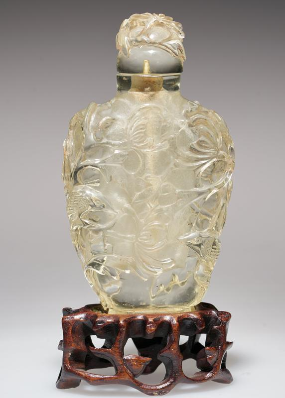 Snuff Bottle, beryl, carved in an all-over design of large flowers. Stopper carved in the form of a flower.